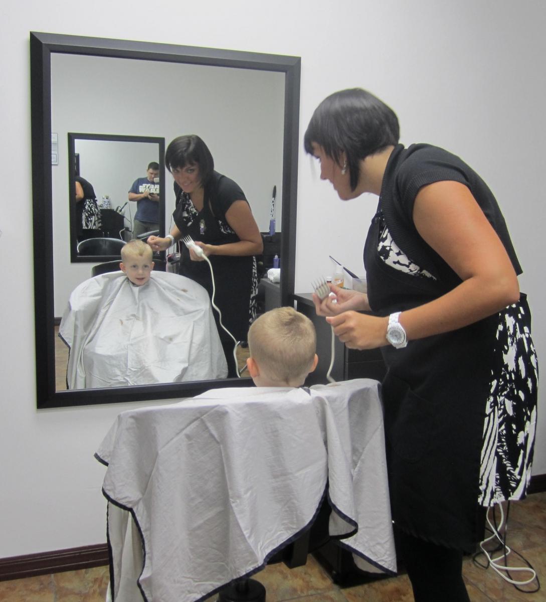 Aimee cutting her nephew's hair