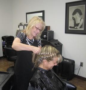 Edi braiding Brenda's hair